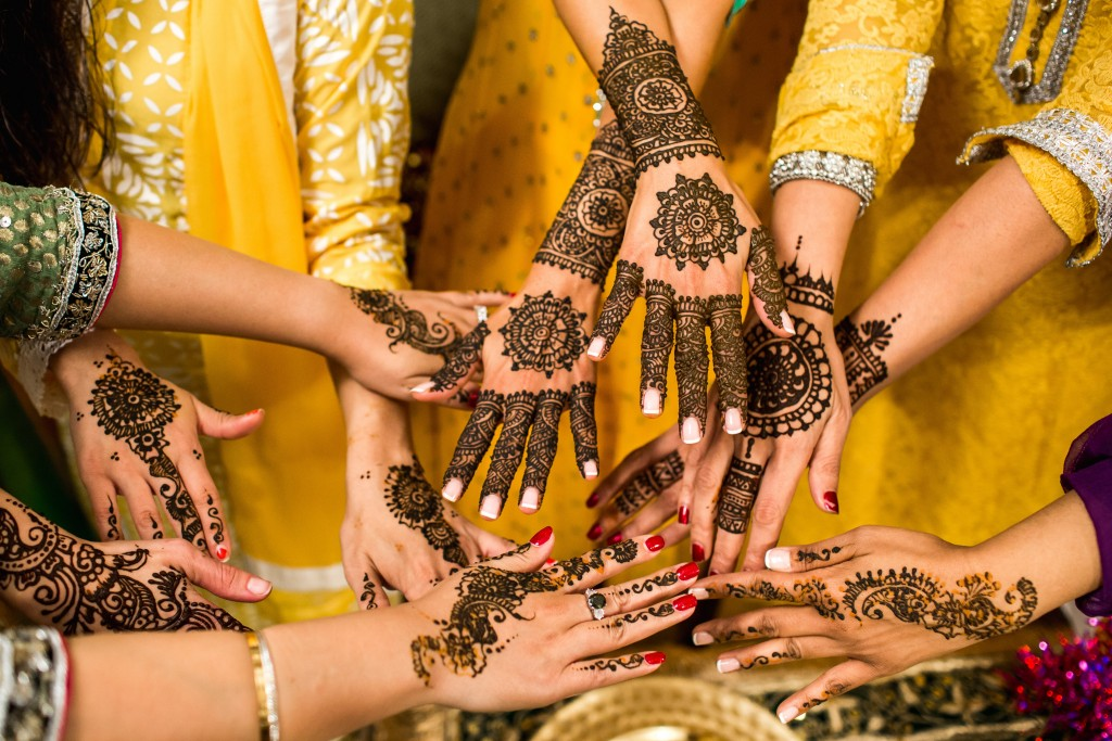 Hands covered in mehndi henna Sikh Wedding