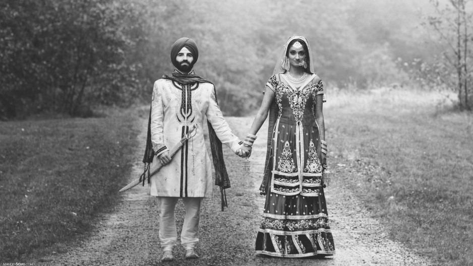 Sikh Marriages and Caste sikh couple holding hands in wedding attire