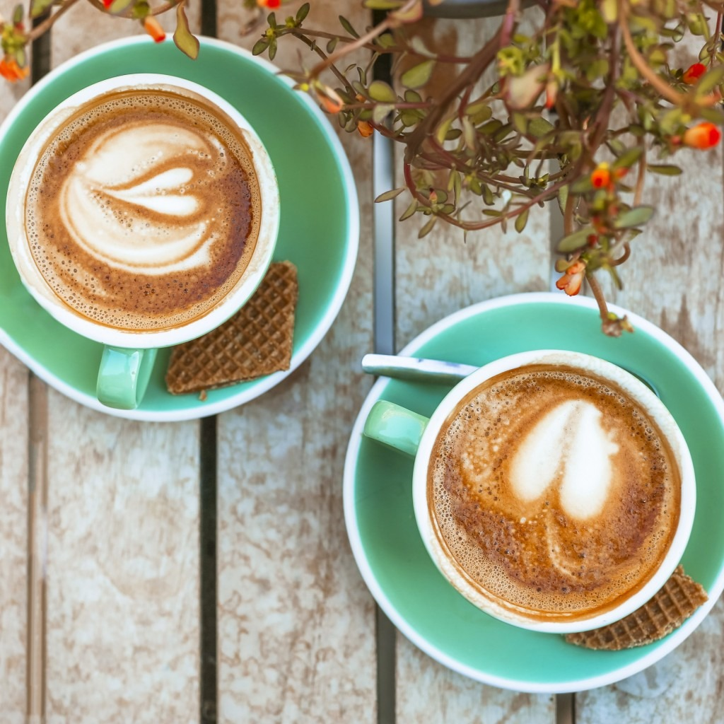 two coffee cups with heart latte art