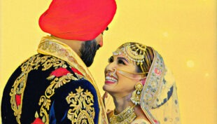 A Sikh Wedding Groom and Bride standing as a couple