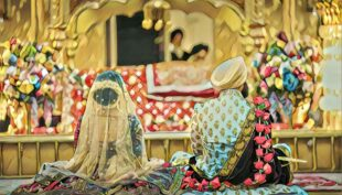 Sikh Couple sitting at a Gurdwara
